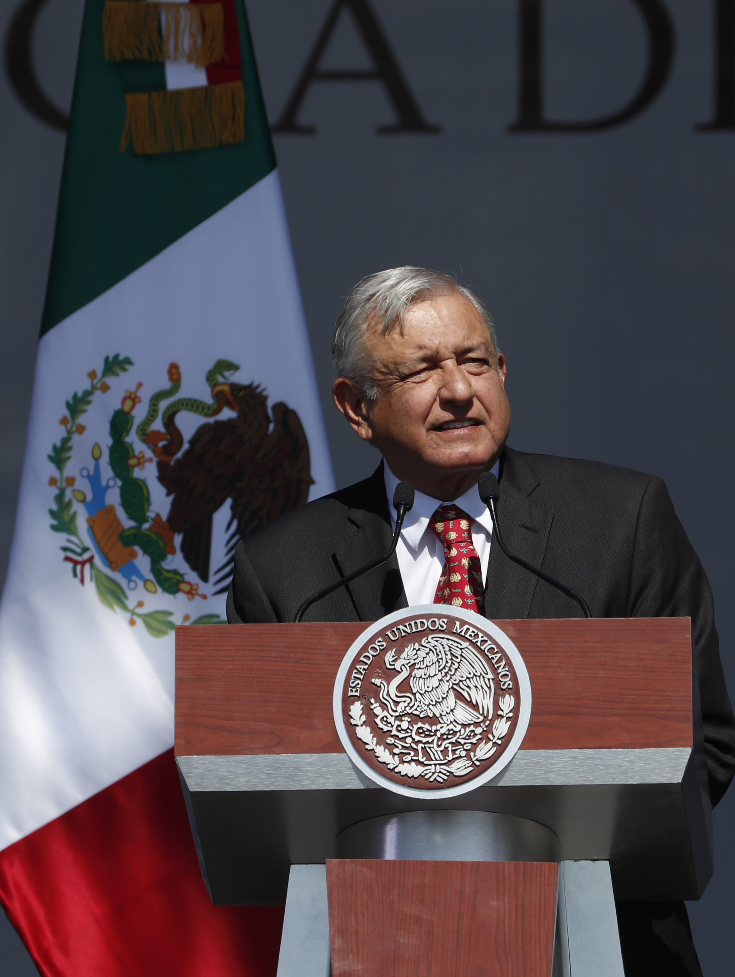 Mexico's President Andres Manuel Lopez Obrador speaks during rally to commemorate his one year anniversary in office, at the capital's main plaza, the Zocalo, in Mexico City, Sunday, December 1, 2019. Thousands of Mexicans have packed into the capital's central square to celebrate Lopez Obrador's first year in office, while thousands more marched down the city's main avenue to protest violence and other ills in the country. (AP Photo/Marco Ugarte)
