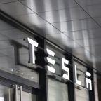Dow Jones Rallies, As Tesla Races Higher On Upgrade; CrowdStrike, Snowflake Surge On Earnings