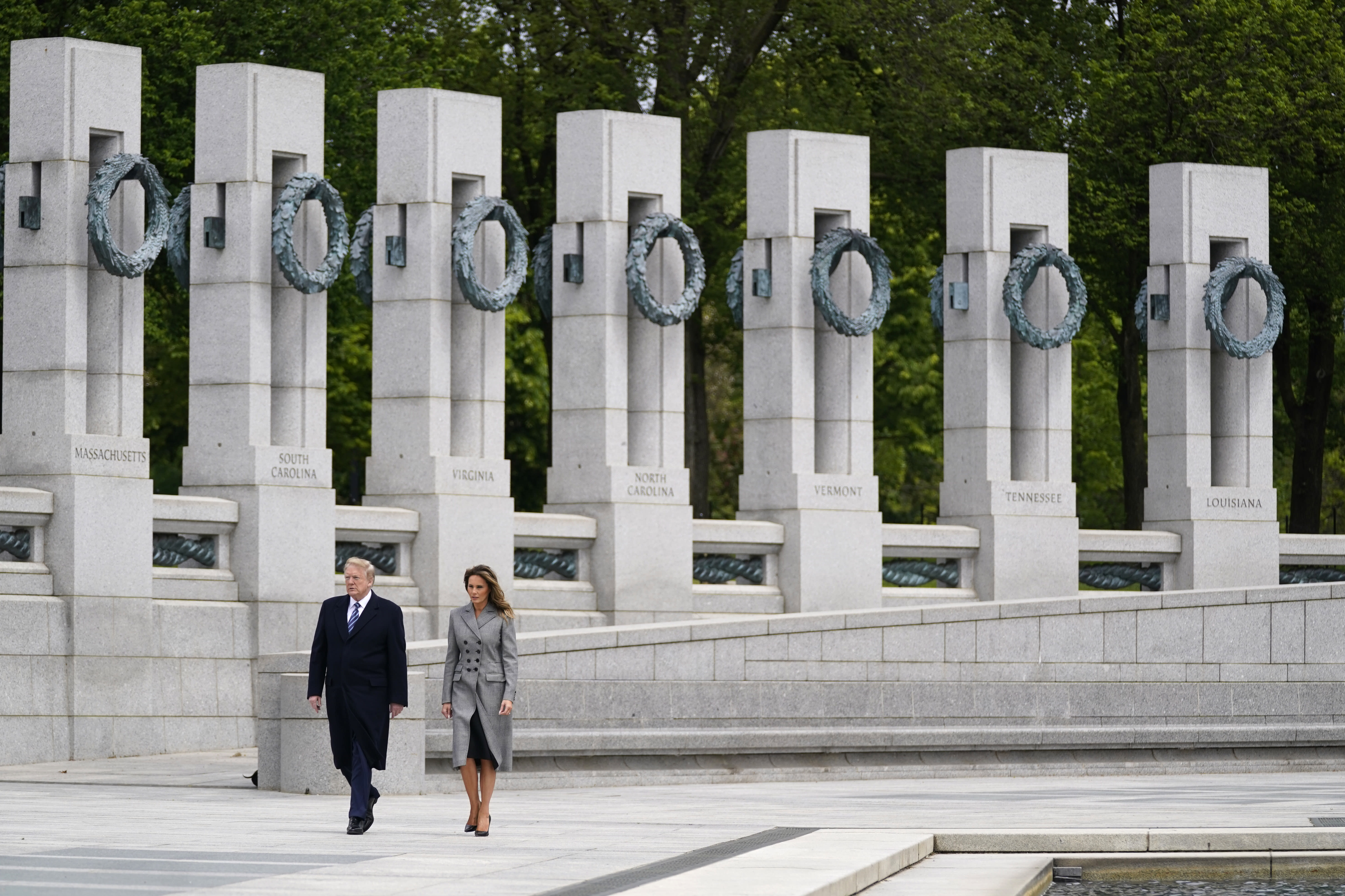 President Donald Trump and first lady Melania Trump visit the World War II Memorial to commemorate the 75th anniversary of Victory in Europe Day, Friday, May 8, 2020, in Washington. (AP Photo/Evan Vucci)