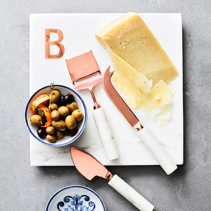 "<p>williams-sonoma.com</p><p><strong>$29.99</strong></p><p><a href=""https://go.redirectingat.com?id=74968X1596630&url=https%3A%2F%2Fwww.williams-sonoma.com%2Fproducts%2Fwhite-marble-monogram-boards&sref=https%3A%2F%2Fwww.delish.com%2Fholiday-recipes%2Fg2573%2Fmothers-day-food-gifts%2F"" rel=""nofollow noopener"" target=""_blank"" data-ylk=""slk:BUY NOW"" class=""link rapid-noclick-resp"">BUY NOW</a></p><p>Add a personal touch by monogramming this chic cheeseboard.</p>"