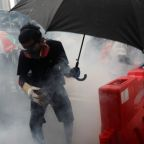 Protest chaos grips Hong Kong with tear gas, water cannon and pouring rain