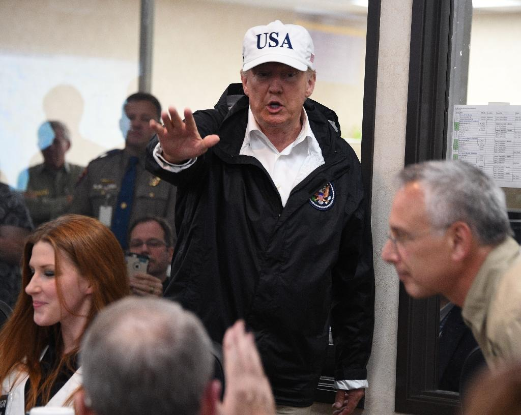 Since unleashing on Friday night, monster storm Harvey has managed to not only halt normal life in Texas but also silence much of the rancor that has pervaded public discourse since Donald Trump came to power. (AFP Photo/JIM WATSON)