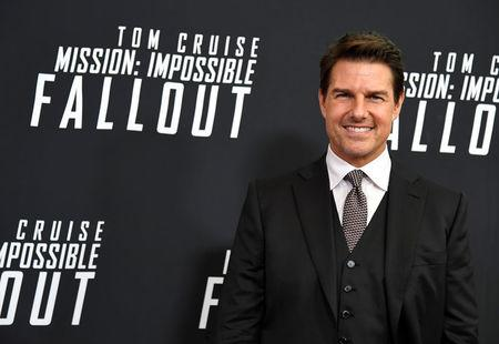 Actor Tom Cruise poses for photographers as he arrives on the red carpet for the premiere of Mission:Impossible-Fallout, at the Smithsonian's National Air and Space Museum, in Washington, U.S., July 22, 2018. REUTERS/Mike Theiler