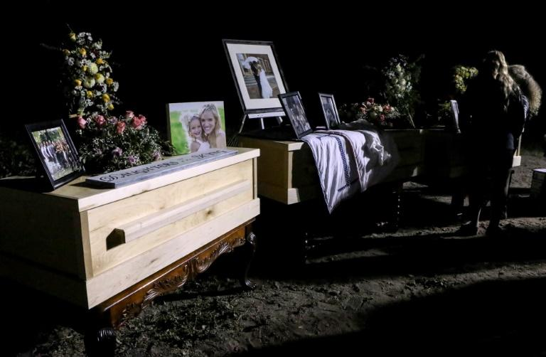 Relatives and friends stand next to coffins holding the remains of Rhonita Miller and four of her children, who were among the nine victims of an attack November 4, 2019, being blamed on a drug cartel in northern Mexico (AFP Photo/HERIKA MARTINEZ)