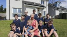 First mum in Britain to have 10 sons in a row finally welcomes a baby girl