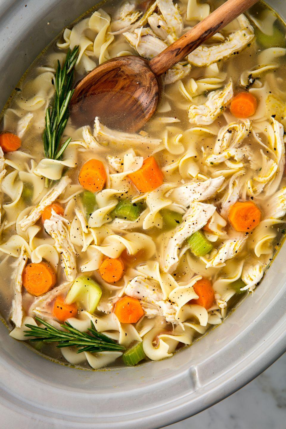"<p>The easiest way to make the most comforting meal.</p><p>Get the recipe from <a href=""https://www.delish.com/cooking/recipe-ideas/recipes/a55661/easy-crockpot-chicken-noodle-soup-recipe/"" rel=""nofollow noopener"" target=""_blank"" data-ylk=""slk:Delish"" class=""link rapid-noclick-resp"">Delish</a>.</p><p><strong><a class=""link rapid-noclick-resp"" href=""https://www.amazon.com/Hamilton-Beach-33262A-Cooker-6-Quart/dp/B00IWOJSJK/ref=sr_1_4?s=home-garden&ie=UTF8&qid=1500676505&sr=1-4&keywords=slow+cooker+hamilton+beach&tag=syn-yahoo-20&ascsubtag=%5Bartid%7C1782.g.1419%5Bsrc%7Cyahoo-us"" rel=""nofollow noopener"" target=""_blank"" data-ylk=""slk:BUY NOW"">BUY NOW</a><em> Hamilton Beach Slow Cooker, $33, amazon.com</em></strong></p>"