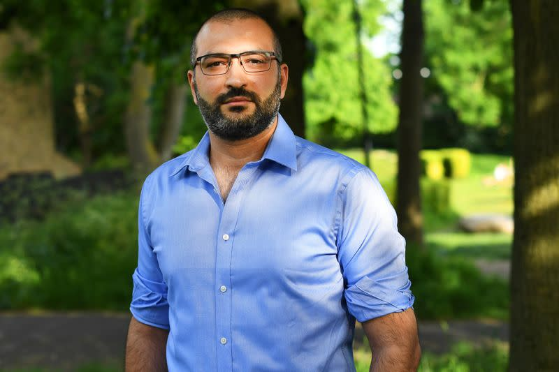 Human rights lawyer Mazen Masri poses for a portrait outside his house in north London