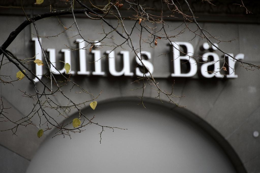 The Swiss Competition Commission says it is investigating two Swiss banks, UBS and Julius Baer, as well as against the foreign financial institutions Deutsche Bank, HSBC, Barclays, Morgan Stanley and Mitsui (AFP Photo/Fabrice Coffrini)