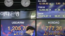 Asian stock prices mixed after Wall Street slips