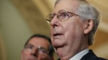 McConnell says Trump is 'not a racist' and calls for Washington to 'tone down' rhetoric