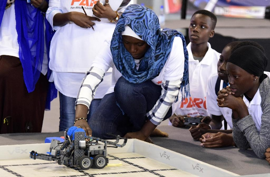 A competitor prepares a robotic vehicle during the final of a robotics competition in the Senegales capital Dakar 0n May 20, 2017