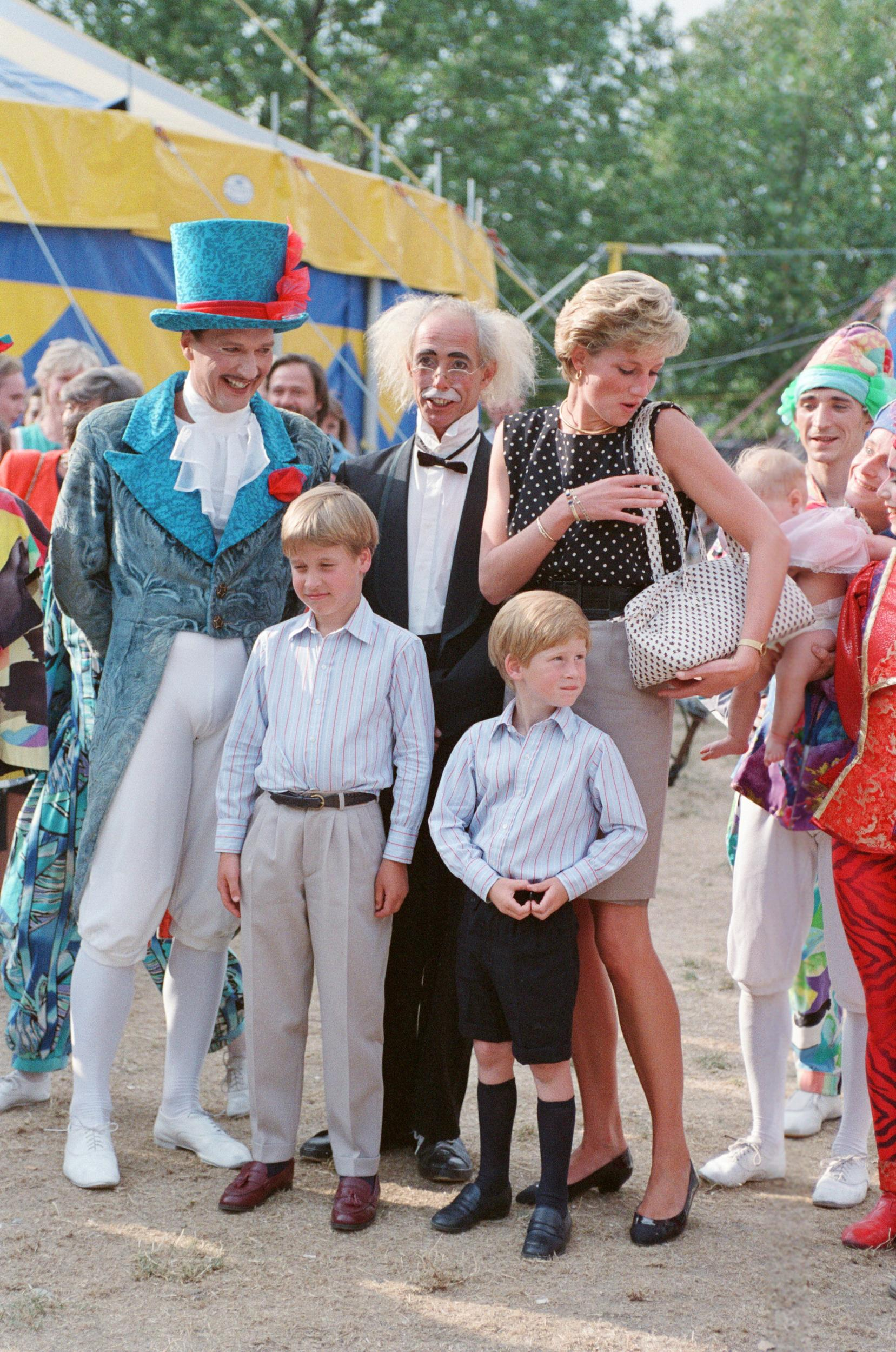 The Princess of Wales, Princess Diana, along with her songs William and Harry enjoy the day at Le Cirque du Soleil, the Children's Circus. Picture taken 8th August 1990. (Photo by Ken Lennox/Mirrorpix/Getty Images)
