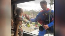 'Superman' visits tiny cancer patient at hospital window