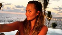Chrissy Teigen shows off post-surgery body in topless selfie