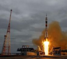 Spaceship carrying three-man crew docks with ISS, NASA TV reports