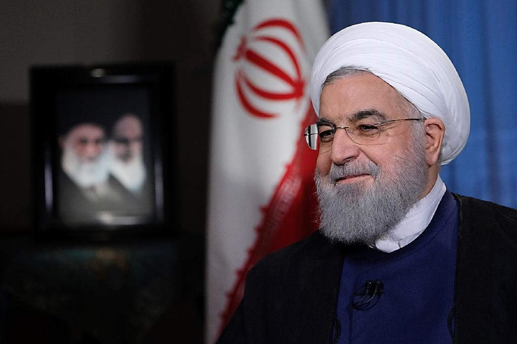Iranian President Hassan Rouhani speaks about his US counterpart Donald Trump's reimposition of crippling sanctions in an August 6, 2018 interview with state television (AFP Photo/-)