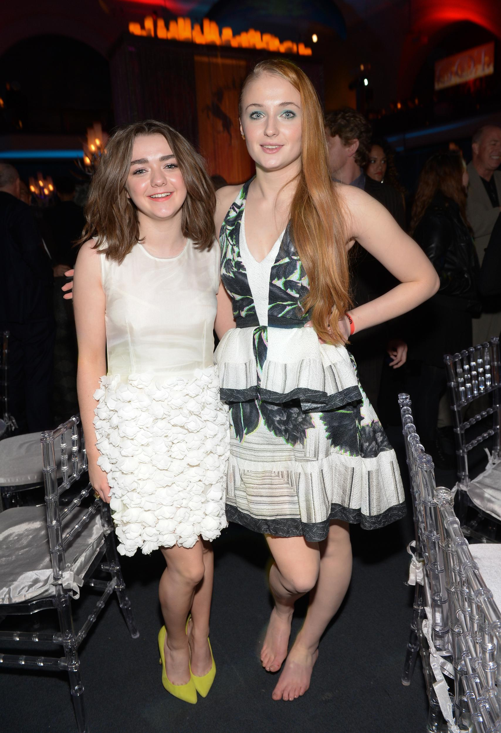 """Actors Maisie Williams, left, and Sophie Turner attend HBO's """"Game of Thrones"""" fourth season premiere after party at the Museum of Natural History on Tuesday, March 18, 2014 in New York. (Photo by Evan Agostini/Invision/AP)"""