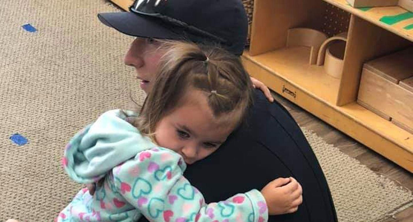 Woman shares heartwarming story behind photo of a little girl getting a hug