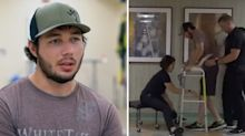 Amazing moment paralysed man walks for first time in five years