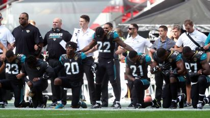 Over 100 NFL players kneel for US anthem