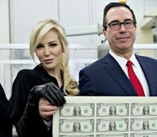 Millionaire Treasury Secretary, Socialite Wife Pose With Sheets Of Cash