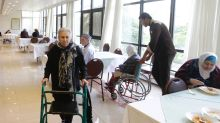 At Syria retirement home, elderly left behind by war