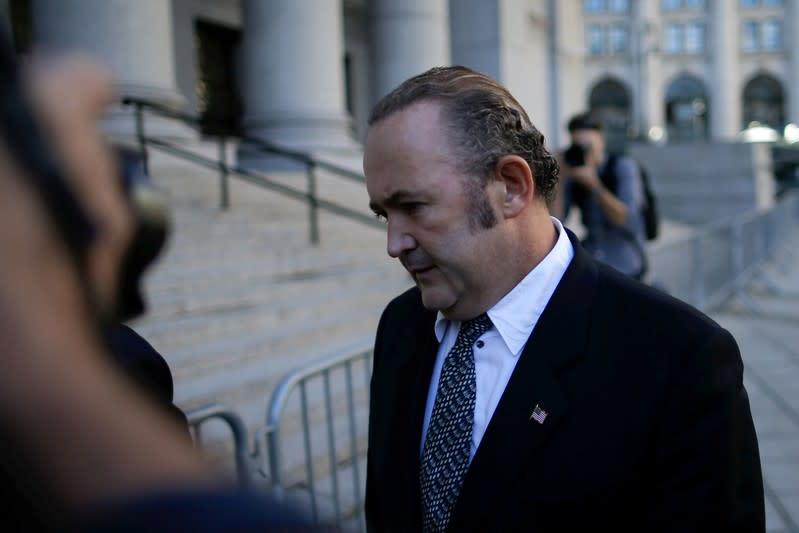 U.S. judge to reconsider house arrest for Giuliani associate