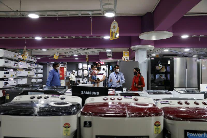 Despite coronavirus, Indian traders stock up in hopes of festive cheer