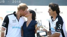 Prince Harry and Meghan Markle 'can't keep their hands off each other'