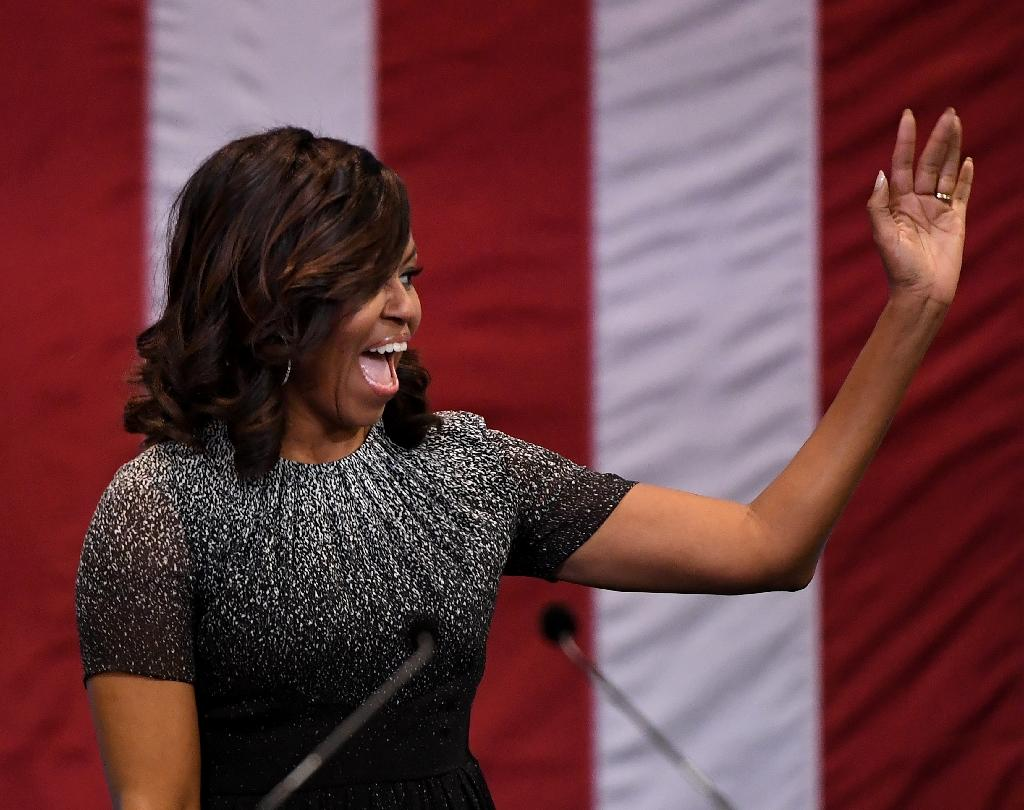 Once a reluctant 'mom-in-chief,' Michelle Obama, the tall, toned Princeton and Harvard graduate -- America's first black first lady -- has evolved, becoming a singular voice for women and a political dynamo (AFP Photo/Mark RALSTON)