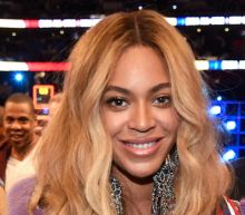 This Is How Beyoncé Styled Her Baby Bump to Sit Courtside with Jay Z and Blue Ivy