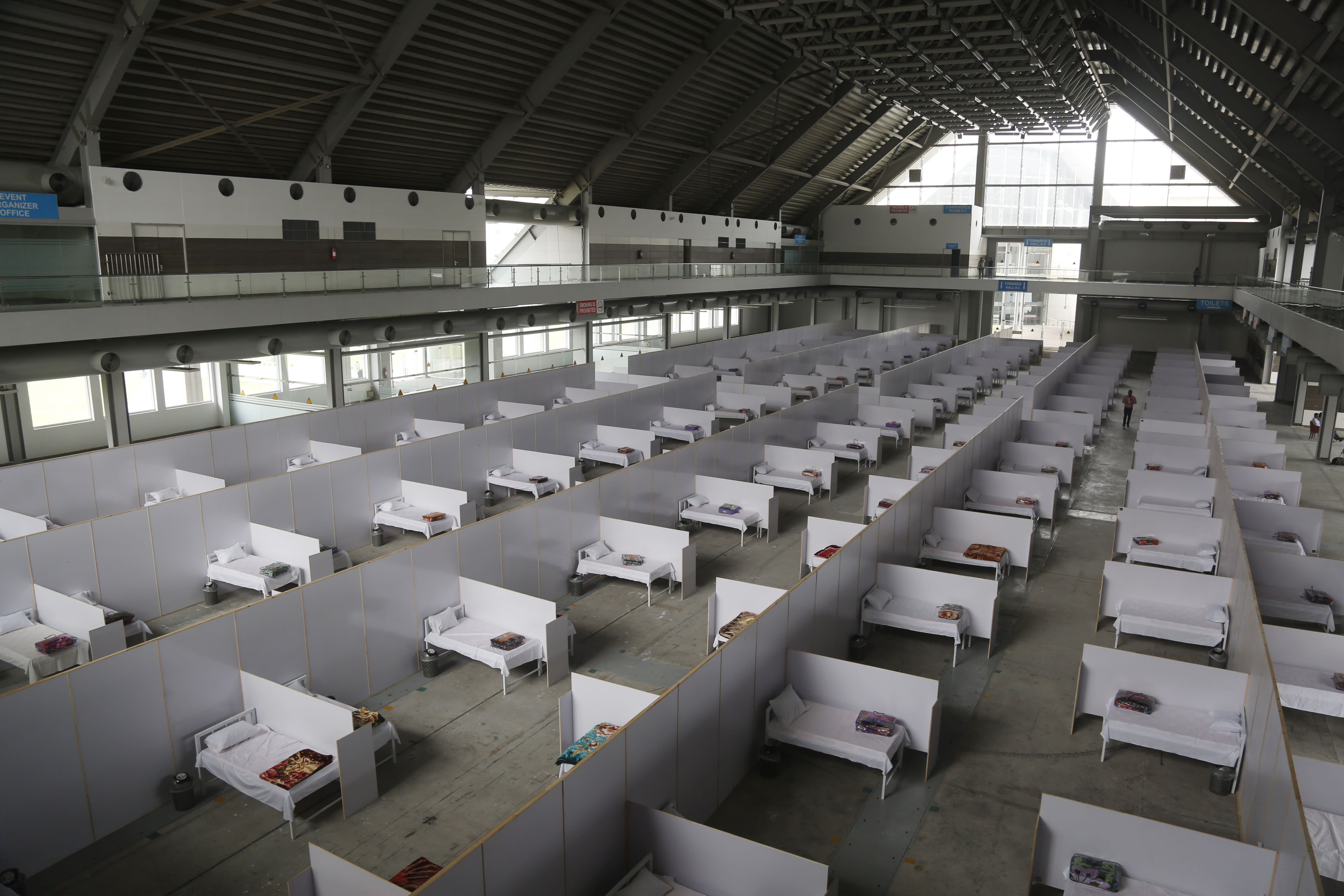 An emergency hospital is set up with nine hundreds beds for coronavirus infected patients, in the Expo Center, Lahore, Pakistan, Thursday, March 26, 2020. The virus causes mild or moderate symptoms for most people, but for some, especially older adults and people with existing health problems, it can cause more severe illness or death. (AP Photo/K.M. Chaudhry)