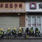 China promises companies aid, global virus cases rise