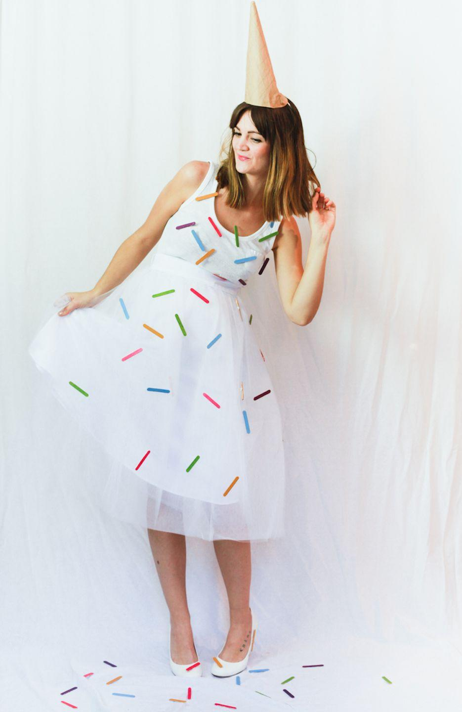 "<p>Bring a taste of summer to October with this whimsical ice cream cone costume, complete with sprinkles on top.</p><p><strong>Get the tutorial at <a href=""http://treasuresandtravelsblog.com/blog/2014/10/24/halloween-costumes-ice-cream-cotton-candy"" rel=""nofollow noopener"" target=""_blank"" data-ylk=""slk:Treasures & Travels"" class=""link rapid-noclick-resp"">Treasures & Travels</a>.</strong></p><p><strong>What you'll need: </strong>white dress ($27; <a href=""https://www.amazon.com/Dantiya-Womens-Sleeve-Elegant-X-Large/dp/B012JN2DKU/"" rel=""nofollow noopener"" target=""_blank"" data-ylk=""slk:amazon.com"" class=""link rapid-noclick-resp"">amazon.com</a>), multicolored mini popsicle sticks ($4; <a href=""https://www.amazon.com/Multicraft-Imports-Mini-Popsicle-Sticks-Colored/dp/B007F0URHE/"" rel=""nofollow noopener"" target=""_blank"" data-ylk=""slk:amazon.com"" class=""link rapid-noclick-resp"">amazon.com</a>), brown paper ($13; <a href=""https://www.amazon.com/Paper-Wrapping-Shipping-Covering-Recycled/dp/B0788YRV9V/ref=sr_1_4?s=arts-crafts&ie=UTF8&qid=1532010971&sr=1-4&keywords=brown+paper"" rel=""nofollow noopener"" target=""_blank"" data-ylk=""slk:amazon.com"" class=""link rapid-noclick-resp"">amazon.com</a>)</p>"