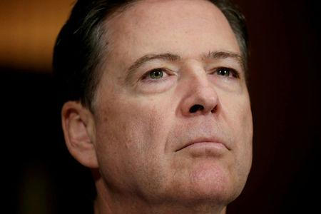 FILE PHOTO: FBI Director Comey arrives to testify at a Senate Judiciary Committee hearing on Capitol Hill in Washington