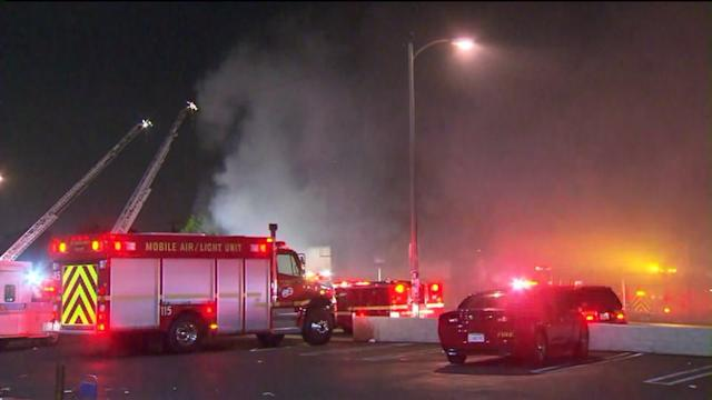 Bodies of Mom, Child Found After Fire Consumes Auto Shop, Loft