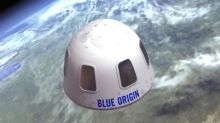 Sold! Bidder pays $28m for spare seat on space flight with Jeff Bezos