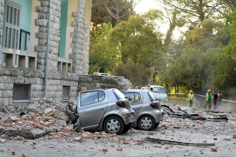 Falling debris pulverised parked cars in Tirana (AFP Photo/Gent SHKULLAKU)