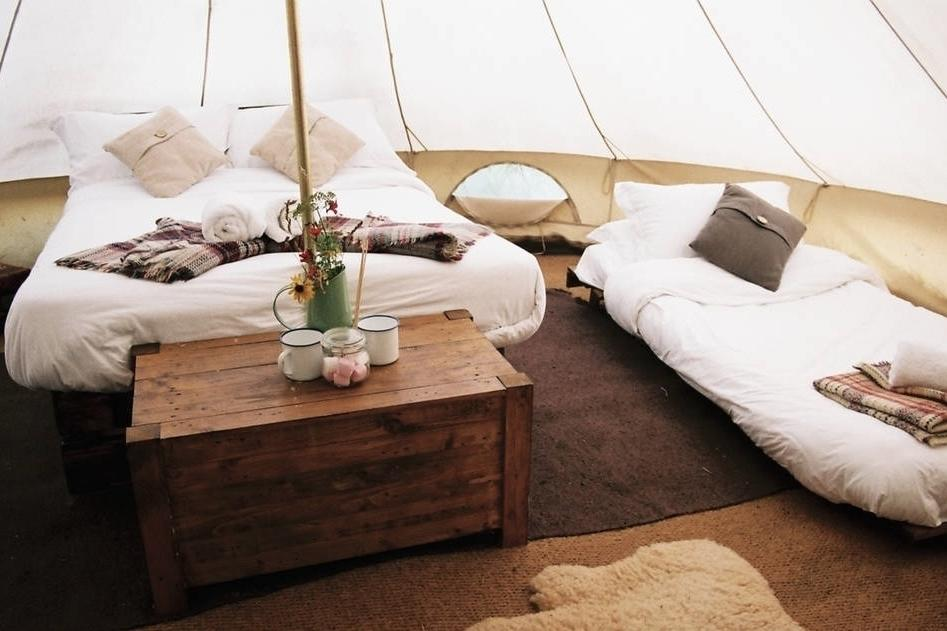 """<p>Explore Bath and its beautiful surrounding countryside from this stylish bell tent, which features a wood burner, plus a games room and indoor heated pool for guests. You and your family can get back to nature with all the comforts of a luxury stay in the beautiful home from home. The <a href=""""https://www.airbnb.co.uk/rooms/1522075"""" target=""""_blank"""">glamping tent</a> provides a rustic interior, cosy beds for four and a sheepskin rug for a warm atmosphere. From £98 per night.</p>"""