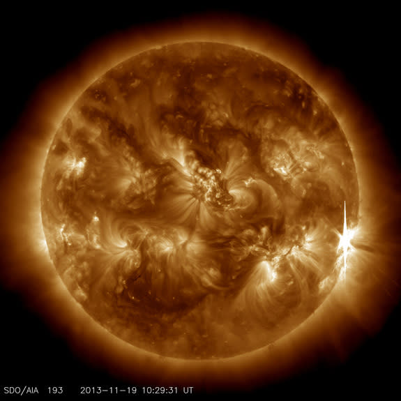 An X1-class flare erupts from the right side of the sun in this image captured by NASA's Solar Dynamics Observatory on Nov. 19, 2013.
