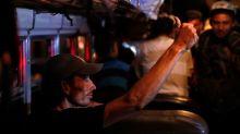 Mexico begins flying, busing migrants back to Honduras