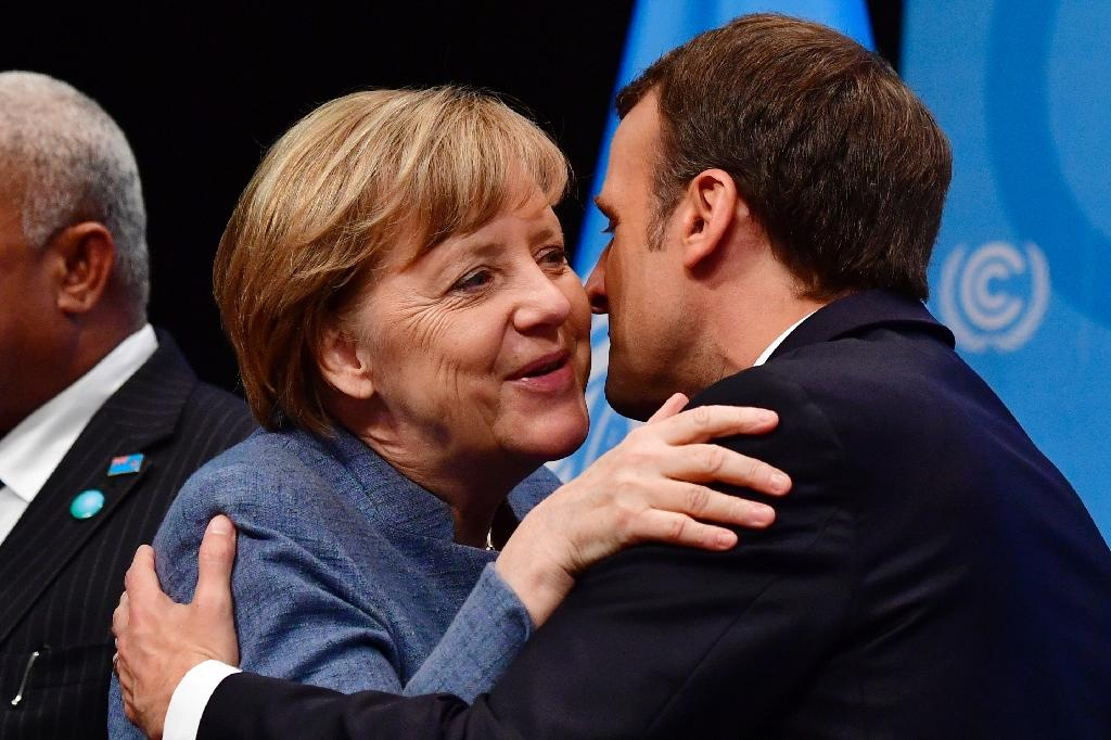 French President Emmanuel Macron has been waiting for German Chancellor Angela Merkel to form a government to start talks in earnest about his European plans (AFP Photo/John MACDOUGALL)
