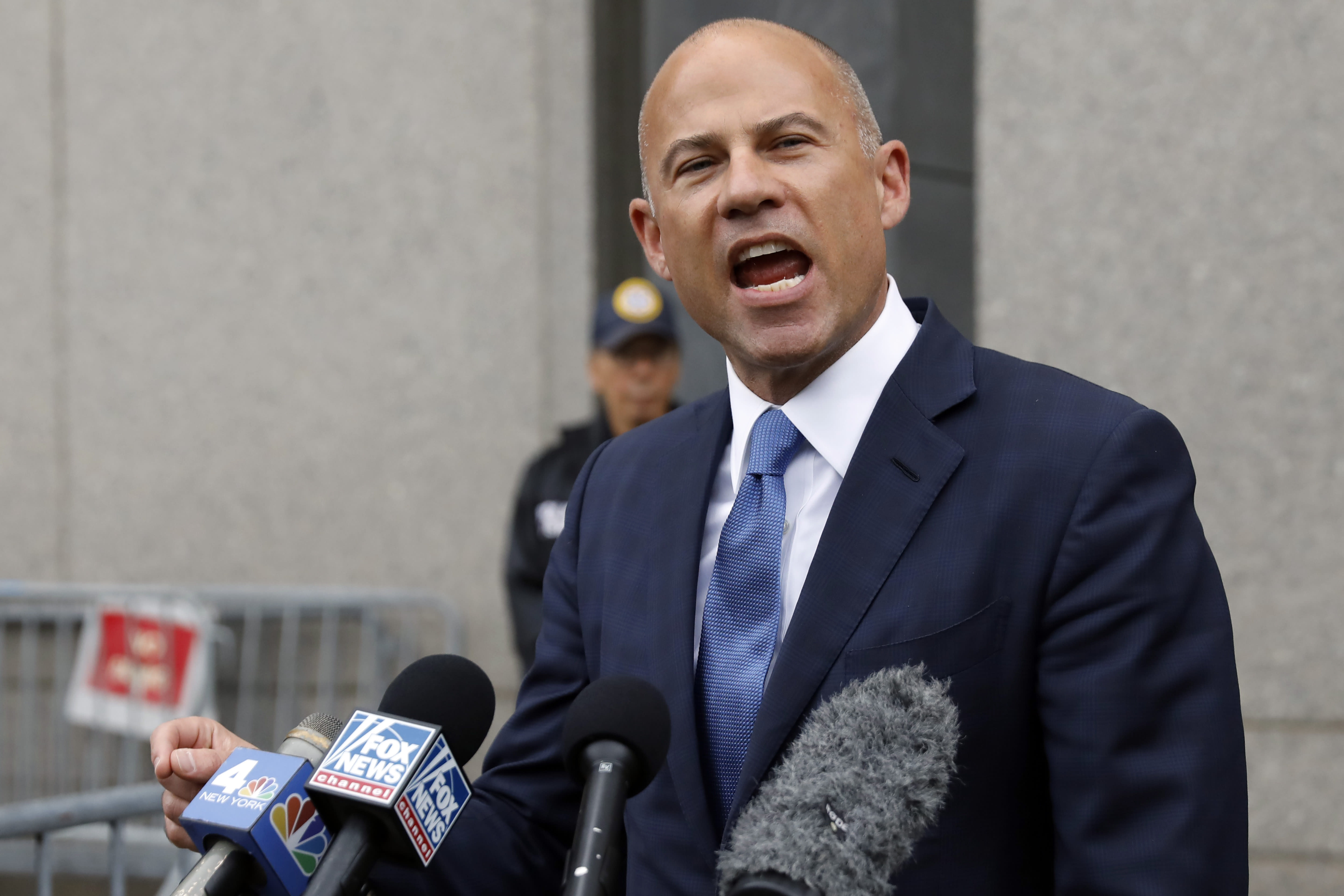 FILE - In this Tuesday, July 23, 2019 file photo, Michael Avenatti makes a statement to the press as he leaves federal court, in New York. Lawyer Michael Avenatti says charging Nike $25 million to probe corruption at the sportswear giant was a bargain rather than extortion. An attorney for Avenatti told a judge Thursday, Aug. 22, 2019 that a November extortion trial should be postponed until January so he can gather more proof. (AP Photo/Richard Drew, File)