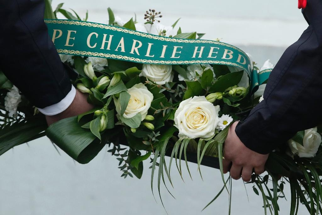 France payed tribute on January 7, 2018 to the victims of the radical Islamist attacks on Charlie Hebdo and a Jewish supermarket three years ago (AFP Photo/CHRISTIAN HARTMANN)