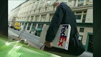 Latest Business News: FedEx Posts Higher Than Expected Profit