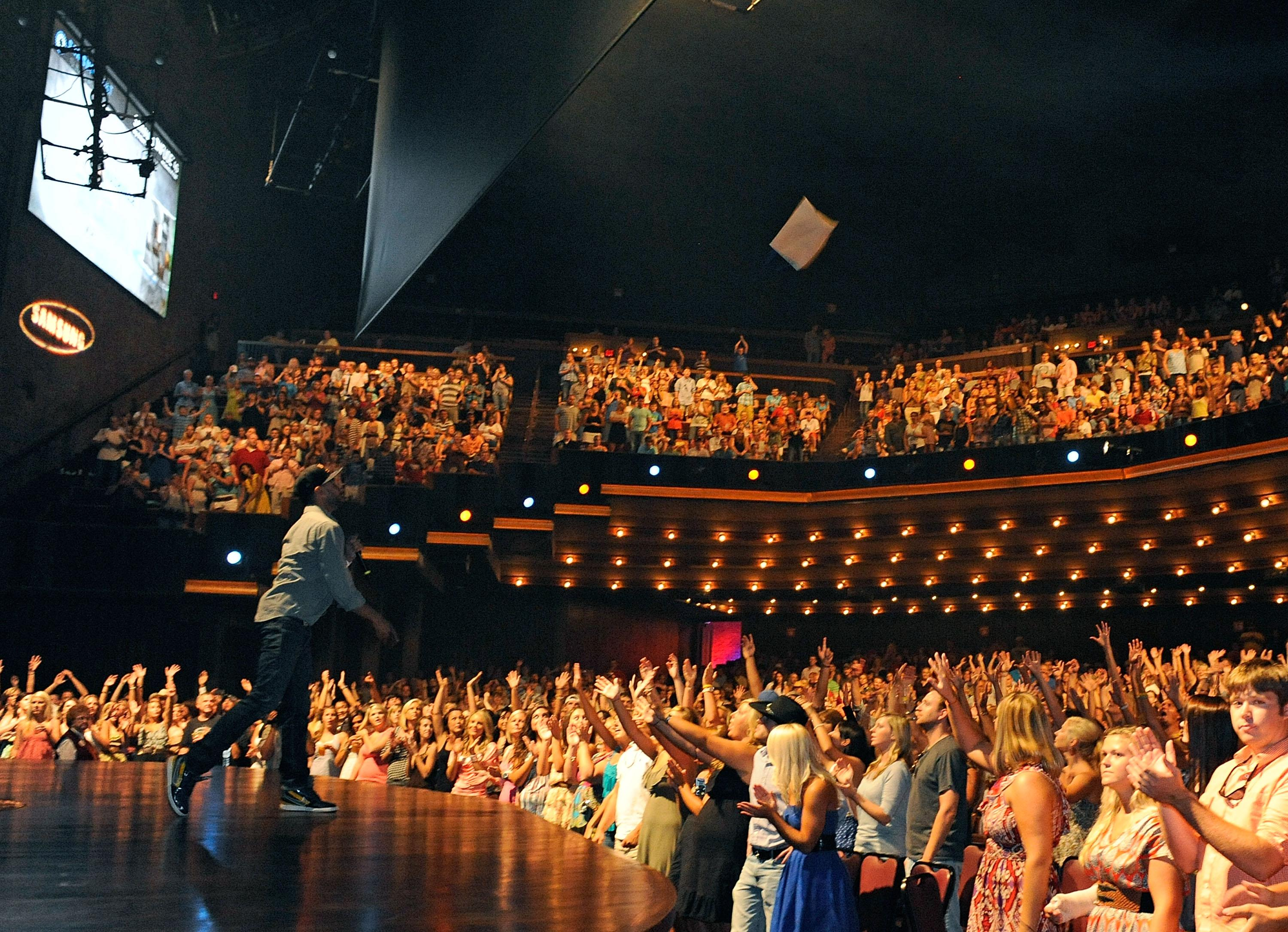 "<strong>Grand Ole Opry - Nashville, TN</strong><br><br>Opened in 1925, the Opry has become known as ""country's most famous stage,"" having showcased a mix of legends and contemporary artists including Patsy Cline, Carrie Underwood, Garth Brooks and the Dixie Chicks. <br><br>(Photo by Frederick Breedon IV/WireImage for Samsung)"