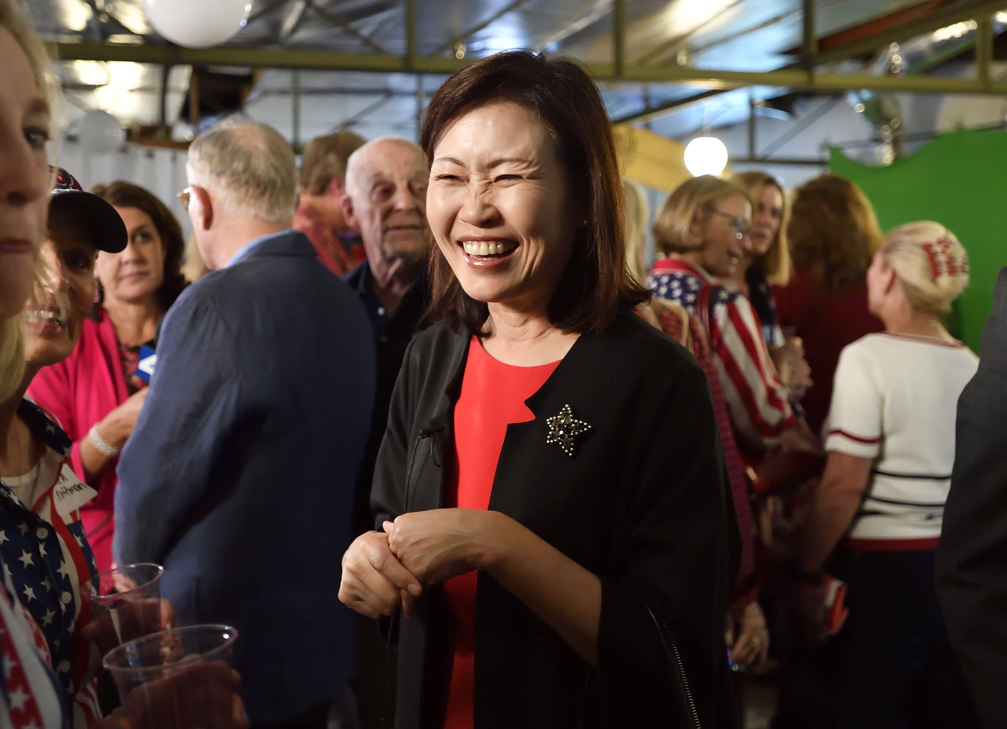 FILE - In this Tuesday, June 5, 2018, file photo Orange County Supervisor Michelle Steel smiles as she visits Rep. Dana Rohrabacher's election night party in Costa Mesa, Calif. Republican Steel, who heads the Orange County Board of Supervisors, has seized on the fight over affirmative action and the new labor law known as AB5 in her bid to oust first-term Democratic Rep. Harley Rouda. (Jeff Gritchen/The Orange County Register via AP, File)