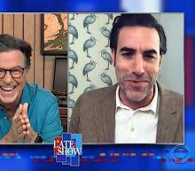 Rudy Giuliani had an ex-cop guarding the door in that Borat hotel scene, Sacha Baron Cohen tells Colbert