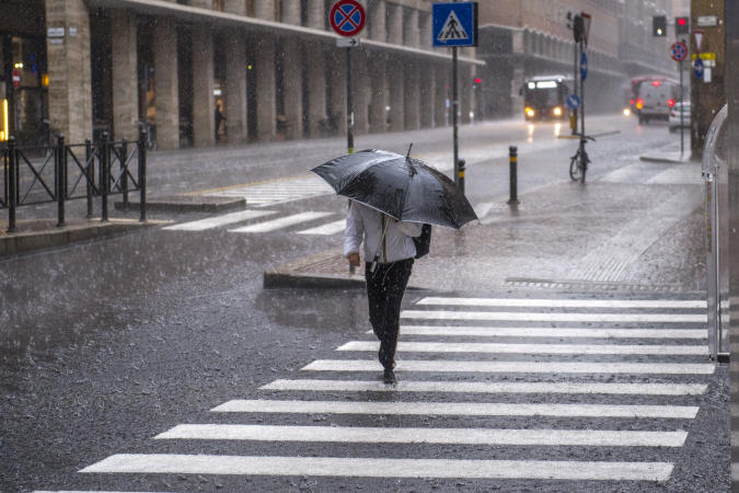 BOLOGNA, ITALY - JUNE 11: A person shelters themself with an umbrella from the violent storm that has hit the city of Bologna on June 11, 2020 in Bologna, Italy. The whole country is returning to normality after more than two months of a nationwide lockdown meant to curb the spread of Covid-19. (Photo by Michele Lapini/Getty Images)