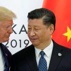 GLOBAL MARKETS-Shares slide on U.S.-China spat over Hong Kong, dollar gains